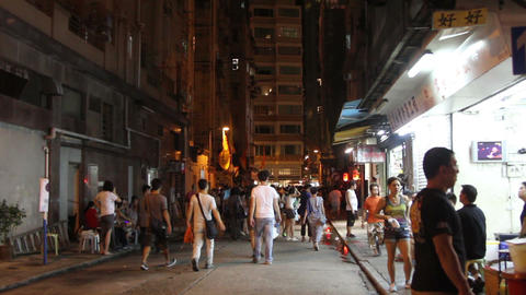 Pedestrians walking on Lan Kwai Fong street in Hong Kong Footage
