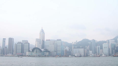 View of city with modern skyscrapers at Victoria Harbour, Hong Kong, China Footage