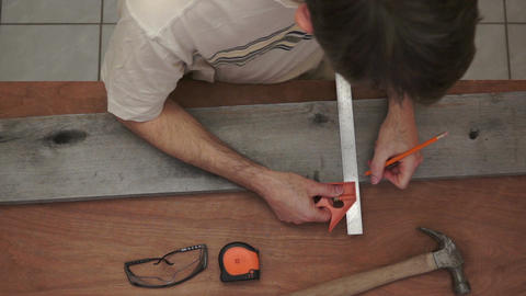Industrial Carpenter Marking Wood Overhead stock footage