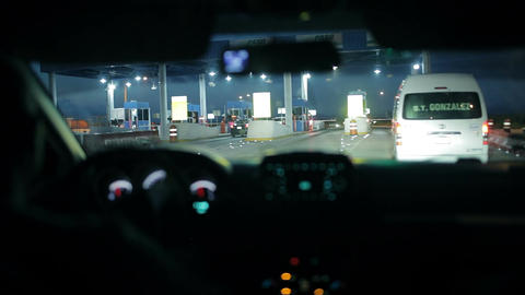 Car at the toll collection point at night Live Action
