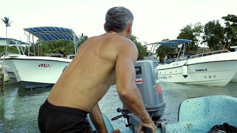 Man starting a motor of boat with several attempts Stock Video Footage