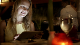 Woman using tablet pc in the restaurant on resort Footage
