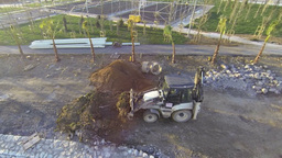 Excavator moving sand soil at construction area vi Footage