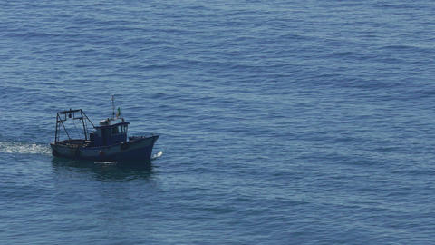 Fishing Boat Floating on the Ocean Waves Footage