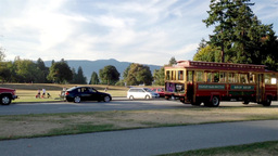 One Side Of Stanley Park With Tourist Bus Passing  stock footage