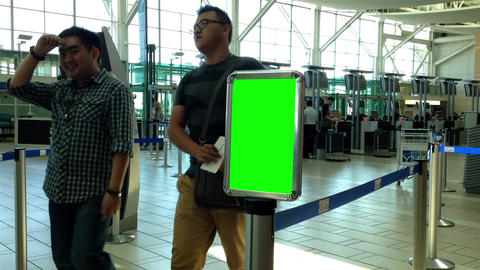 Green Billboard For Custom Content Inside YVR Airp stock footage