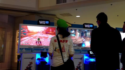 Wii store stuff demonstrates car racing game insid Live Action