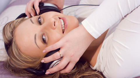 Attractive young woman listening to music Footage