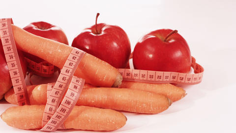 Red Apples, Carrots And Measure Tape stock footage