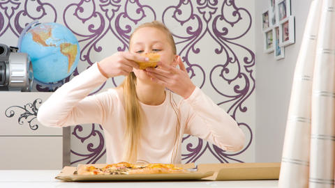 Hungry Girl Eating Delicious Pizza stock footage