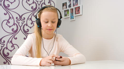 Young girl listening to music and singing Footage