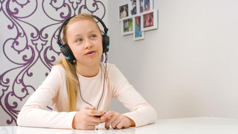 Singing girl with headphones Footage