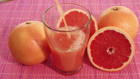 Grapefruit juice and grapefruits Footage