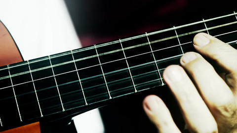 Musician and Acoustic Guitar 13 playing closeup stylized... Stock Video Footage