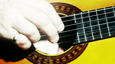Musician and Acoustic Guitar 15 playing closeup stylized... Stock Video Footage