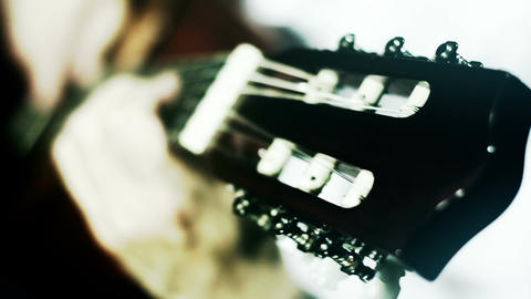 Musician and Acoustic Guitar 17 playing wide angle stylized artcolored Footage