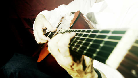 Musician and Acoustic Guitar 19 playing wide angle stylized artcolored Footage