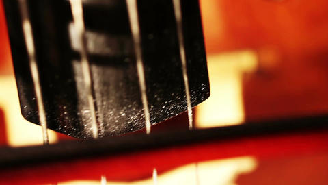 Musician and Double Bass 12 strings and bow extreme closeup Stock Video Footage