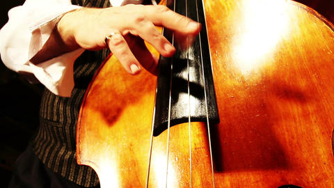 Musician and Double Bass 22 playing jazz wide low angle Footage