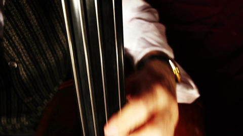 Musician and Double Bass 24 playing jazz wide low angle Stock Video Footage