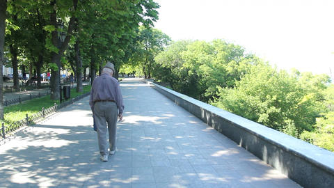 An old men walks along the street of Odessa Footage