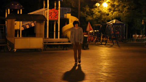 a playground at night and teenager Footage