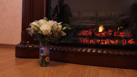 two wedding bouquet against the background fireplace Footage