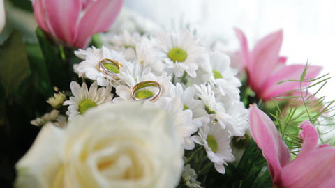 a wedding rings on the flowers Footage