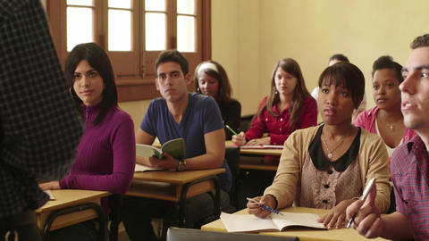 Teacher Speaking To Students In College Class Footage