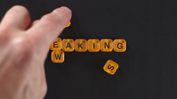 Orange Letter Blocks Spell Breaking News stock footage