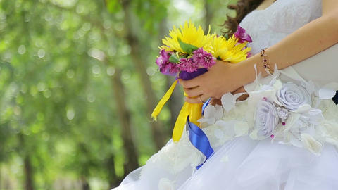 Bride is holding a bouquet Live Action