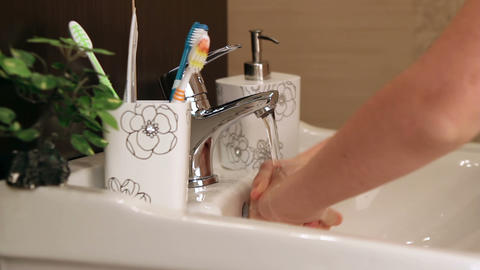 Little Girl Washes Her Hands stock footage