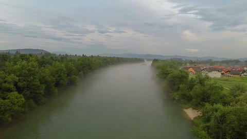 AERIAL: Misty river in early spring Footage