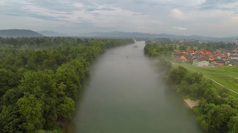AERIAL: Misty river by the small town Footage