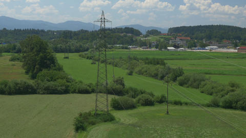 AERIAL: Electricity Pylons stock footage