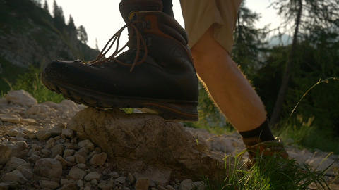 SLOW MOTION: Hiking The Mountains Cluseup stock footage