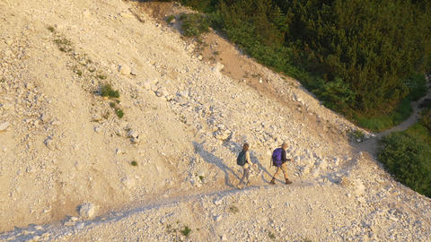 AERIAL: Young hikers trekking over the scree in th Footage