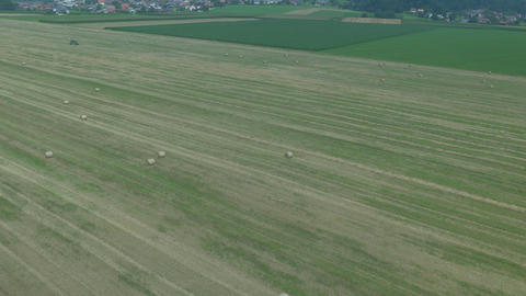 AERIAL: Bales of hay on a harvested field Footage