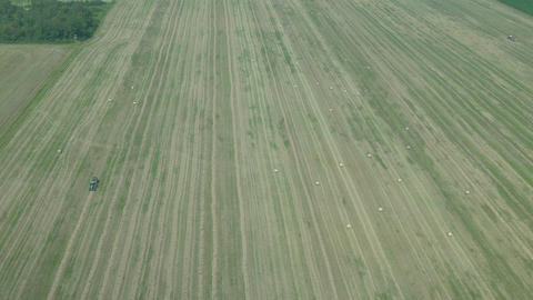 AERIAL: Wide fields with bales of hay Footage
