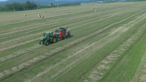 AERIAL: Making bales of hay with agricultural mach Footage