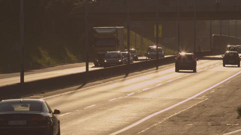 SLOW MOTION: Cars and trucks driving along the bus Footage