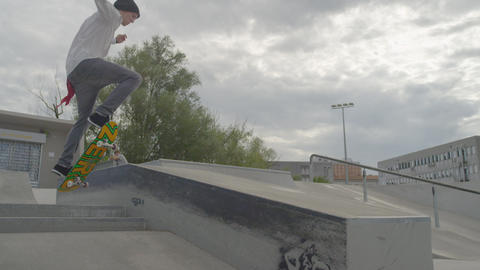 SLOW MOTION: Skateboarder does a manual on a box i Footage