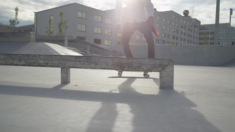 SLOW MOTION: Skateboarder jumps on his skate and s Footage