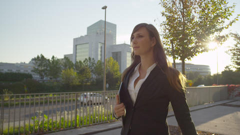 CLOSE UP: Successful young business woman walking  Footage