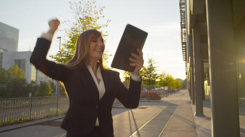Cheerful businesswoman gets exciting news on digit Footage
