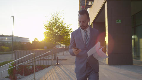 Business gets good news and throws up his papers Footage