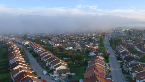 AERIAL: Foggy morning in idyllic suburban town Footage
