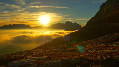 AERIAL: Sunny mountaintop above the sunset clouds Footage