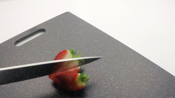 chopping strawberry Stock Video Footage