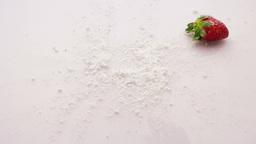 strawberry falling on sugar powder Footage
